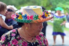 Cook Islander woman wearing a Rito hat in Avarua Rarotonga. Cook Islander woman wearing a Rito hat. Rito hats are worn by women to church. They are made from the Royalty Free Stock Image
