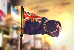 Cook Islands Flag Against City Blurred Background At Sunrise Bac Royalty Free Stock Photography