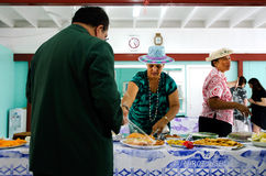 Cook Islands woman serve traditional food on sunday morning tea Royalty Free Stock Image