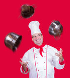Cook juggles with pot Royalty Free Stock Photo