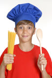Cook kid. Little chef kid holding a bunch of crude spaghetti on white background.Little kid holding pasta Stock Image