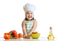 Cook kid girl preparing vegetables Royalty Free Stock Photo