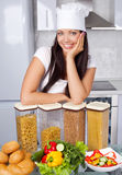 Cook in the kitchen Stock Photography