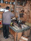 Cook in kitchen in one of lodges of Timang - Nepal Royalty Free Stock Photo