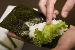 Cook on kitchen prepares Japanese susi. Cook on a kitchen prepares Japanese susi royalty free stock photography