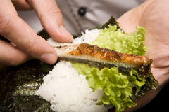 Cook on kitchen prepares Japanese susi. Cook on a kitchen prepares Japanese susi stock image