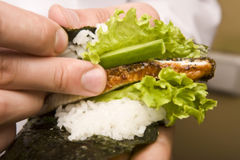 Cook on kitchen prepares Japanese susi. Cook on a kitchen prepares Japanese susi royalty free stock images