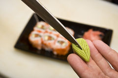 Cook on kitchen prepares Japanese susi stock photo
