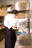 Cook in a kitchen Stock Photography