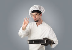 Cook with kitchen tools and empty wallpaper Royalty Free Stock Images