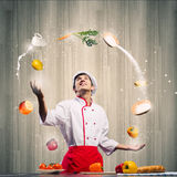 Cook at kitchen Royalty Free Stock Image