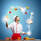 Cook at kitchen Royalty Free Stock Photos