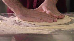 Cook preparing pizza dough stock footage