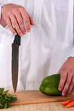 Cook with a knife Royalty Free Stock Images