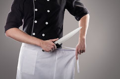 Cook with knife, front view. 3D rendering and photo. High resolution. Cook with knifes, front view. Grey backgrouund stock photo