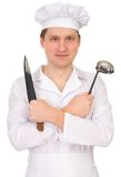 Cook with knife and ladle Stock Photos