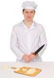 Cook with knife and preparation board Stock Photo