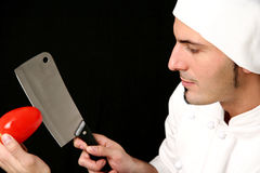 Cook with knife and tomato Royalty Free Stock Image