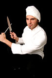 Cook with knifes Stock Images