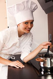 Cook lady with saucepan Stock Photo