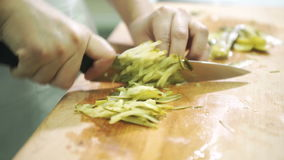 Cook a large knife on the board chopped salted canned cucumbers. stock footage