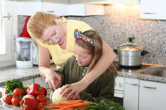 Cook learning. Mom learning daughter to cooking royalty free stock image