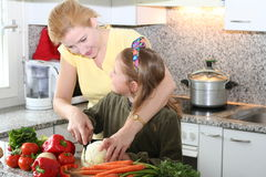Cook learning. Mom learning daughter to cooking royalty free stock photos
