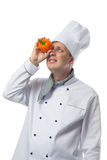 Cook looks to the pepper in the hand Stock Photos