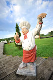 A cook made in ceramic in a garden. A cook made in ceramic in a restaurant garden Stock Photography