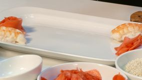 The cook makes a beautiful serving of sushi. Fast moving. stock video footage