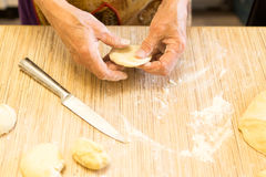 Cook makes pies of dough Stock Photo