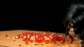 The cook makes salsa. Salsa for burgers on hot Mexican hot recipes. It is prepared from a tomato, red chili peppers. Onions, white onions. All chalks are cut stock video footage
