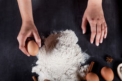 Cook is making cookies from eggs, flour, cinnamon and anise Royalty Free Stock Photos