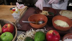 Cook making desserts with wild berries in restaurant kitchen stock footage