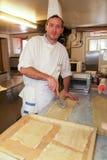 Cook making fresh egg pasta Royalty Free Stock Image