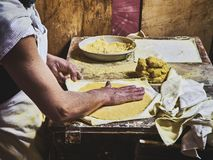 Cook making Tortillas on a wooden rustic table royalty free stock photo
