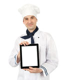 Cook man. Young cook man showing a digital tablet Royalty Free Stock Photography