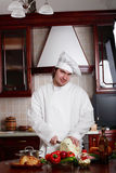 Cook man. Cook cooking on the kitchen Royalty Free Stock Photos