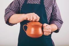 Cook man with big pot Royalty Free Stock Photo