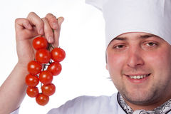 Cook man has cherry tomatoes Royalty Free Stock Photography