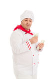 Cook man holding fan of dollars wearing white uniform Royalty Free Stock Image
