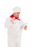 Cook man holding notebook and pen, thinking Stock Photography