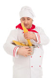 Cook man holding pan filled with raw macaroni wearing white unif Royalty Free Stock Image