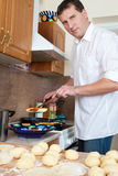 Cook man in kitchen Royalty Free Stock Photo