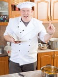 Cook man in kitchen Stock Images