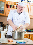 Cook man in kitchen Royalty Free Stock Images