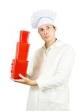 Cook man with red packages Stock Photography