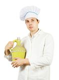 Cook man in toque with bottle Royalty Free Stock Photo