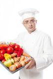 Cook man with vegetables Royalty Free Stock Images