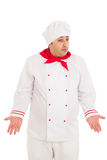 Cook man wearing white uniform express amazement. Over white background Stock Photos